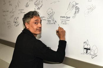 """LOS ANGELES, CALIFORNIA - AUGUST 12: Taika Waititi signs an autograph at the """"Free Guy"""" Opening Nigh..."""