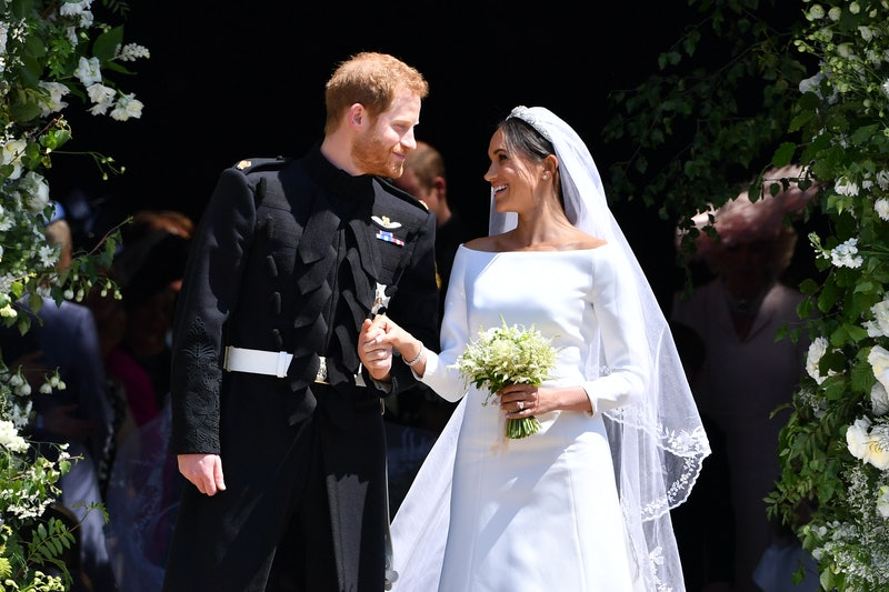WINDSOR, UNITED KINGDOM - MAY 19: Britain's Prince Harry, Duke of Sussex and his wife Meghan, Duches...