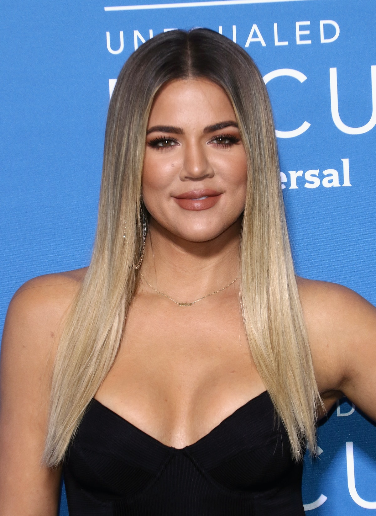 Khloé Kardashian is embracing her naturally curly hair, and it's so nice to see.