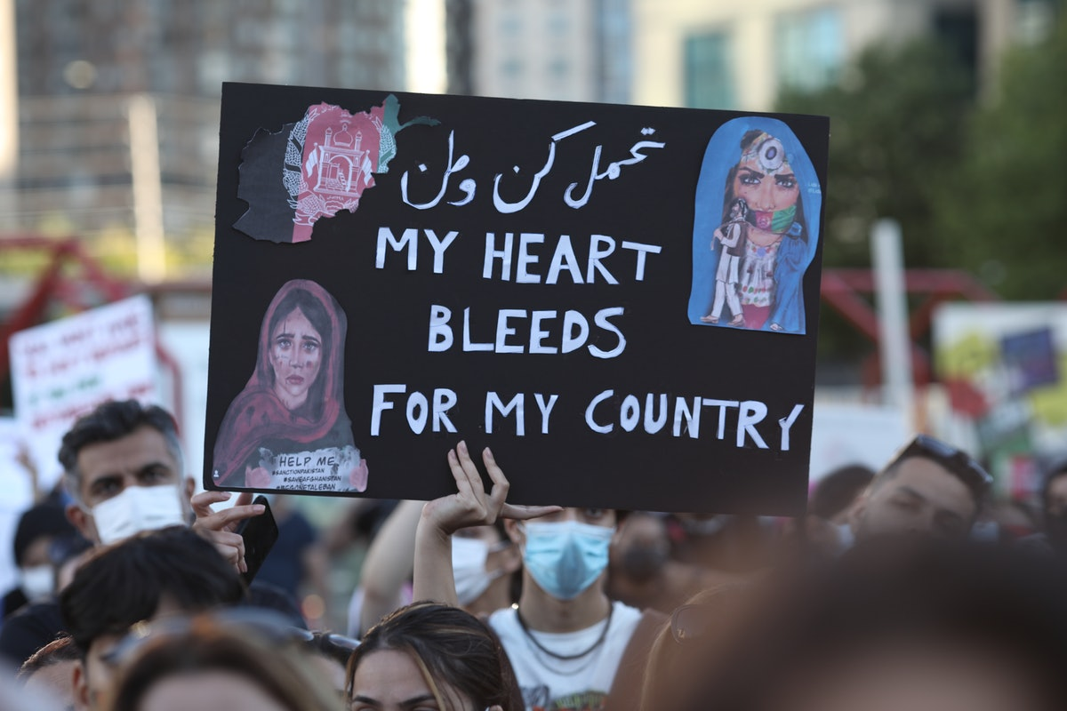Dozens of Afghan gathered for a rally in solidarity with their countrymen on Sunday, on August 15, 2...