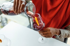 woman pouring wine in a glass