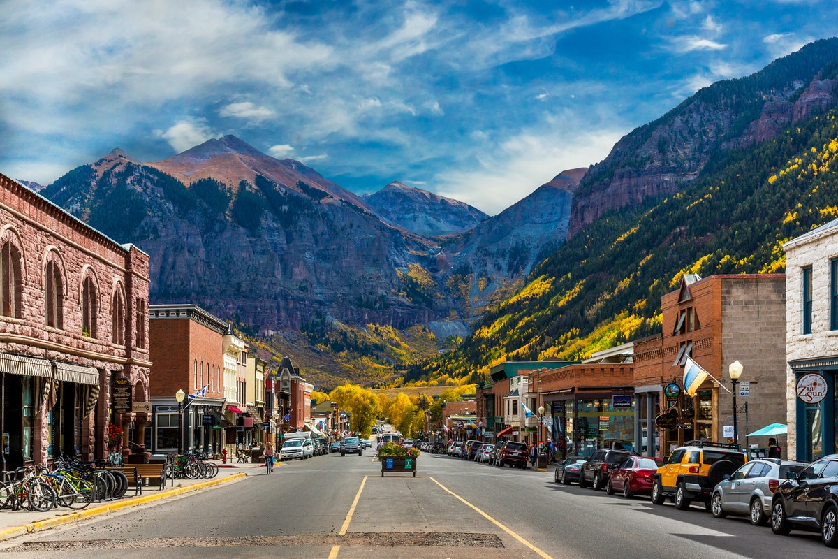 A look down Main Street in Telluride during Peak Autumn Color from the Aspens with a mountain backdr...