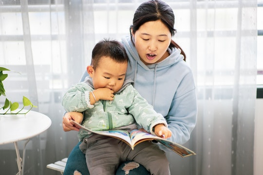 Mother with son reading a book together