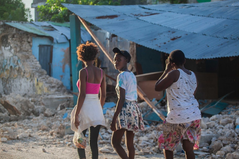 Haitians walk the street after a 7.2-magnitude earthquake on August 15, 2021. Here are places to don...
