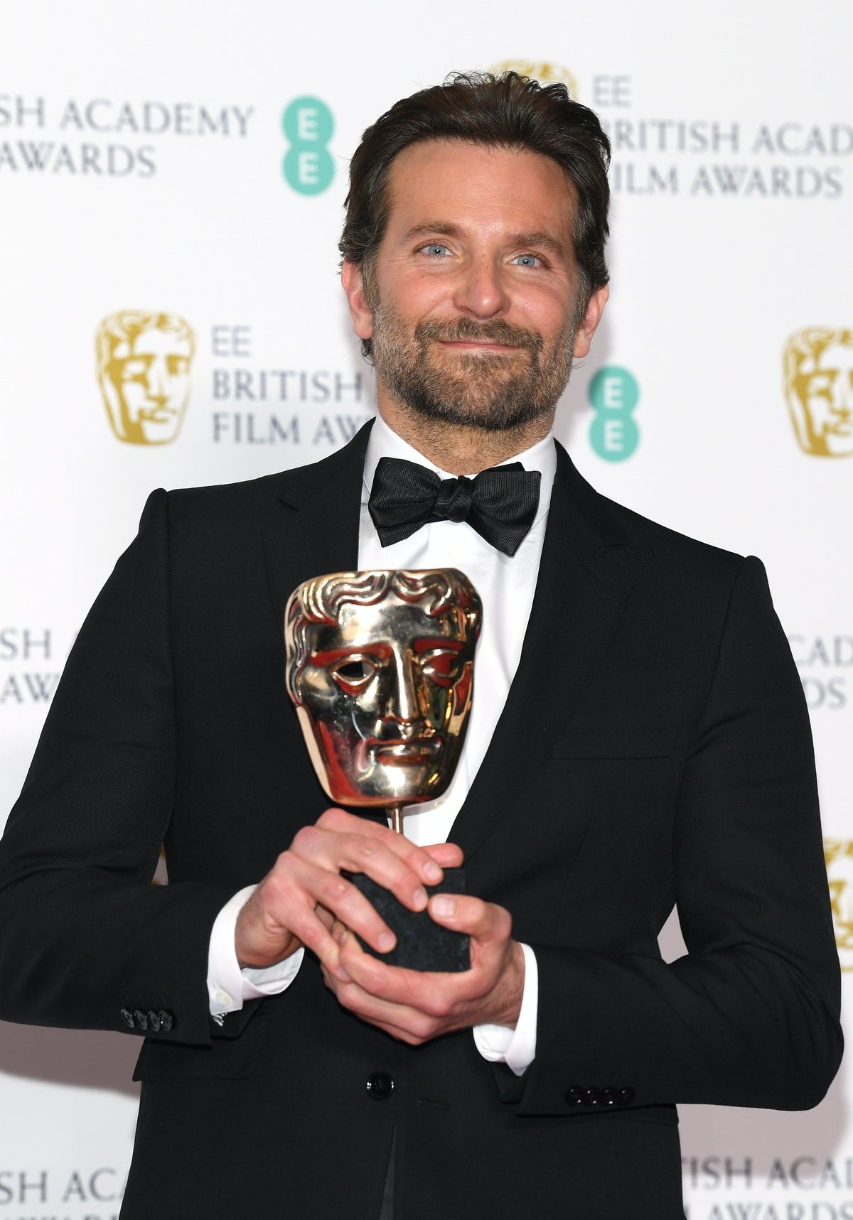 LONDON, ENGLAND - FEBRUARY 10:  Winner of the Original Music award for A Star Is Born, Bradley Coope...
