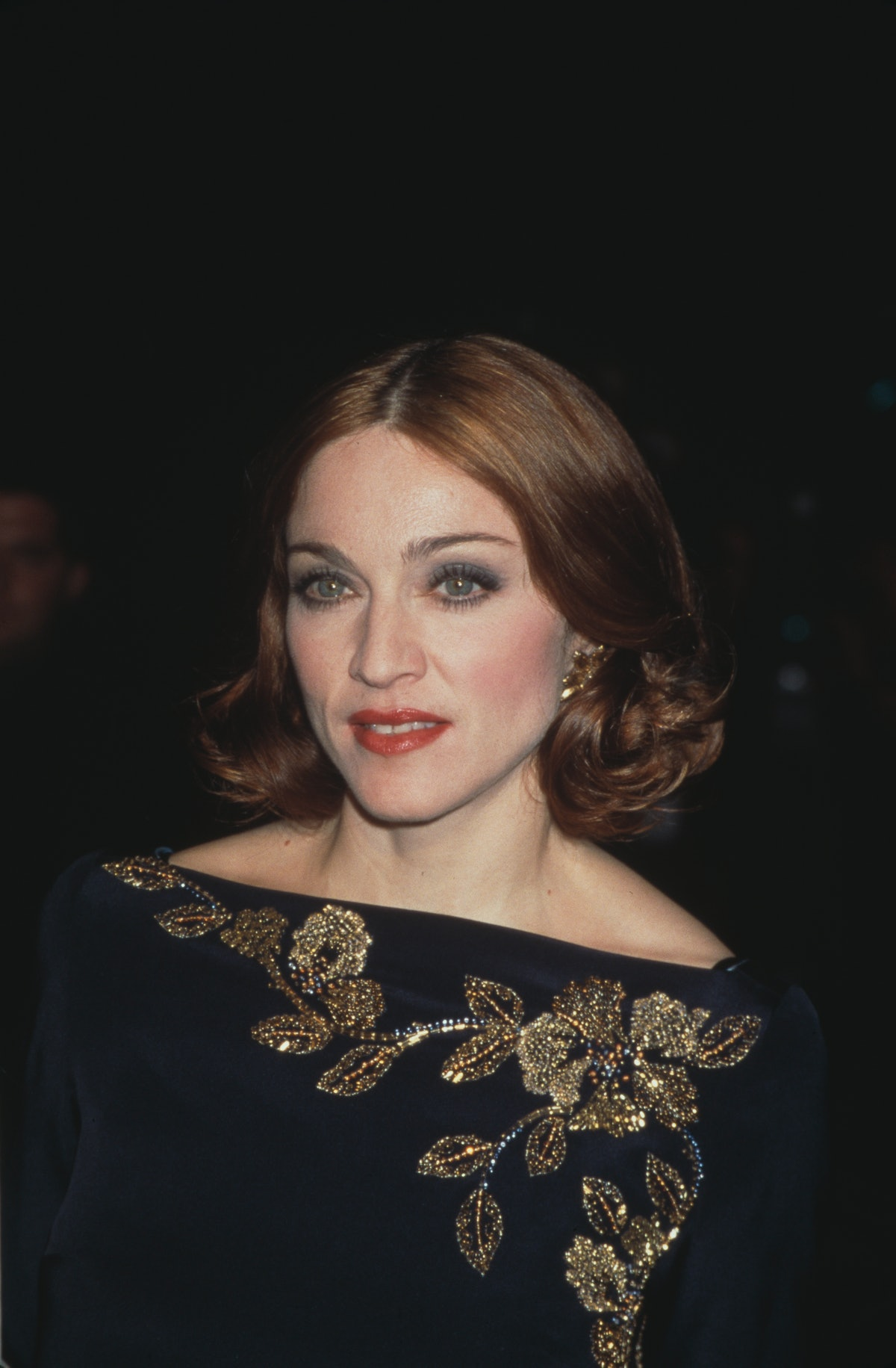 American singer-songwriter and actress Madonna, wearing a blue outfit decorated with gold leaves, at...
