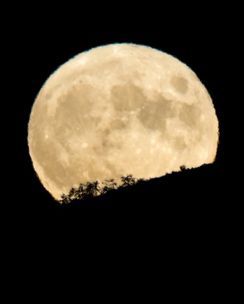 Boise, ID, USA - July 23, 2021: July full moon also known as Buck Moon rises over Boise Idaho sky in...