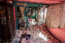 LES CAYES, HAITI - AUGUST 16: A man cleans the debris at his house after a 7.2-magnitude earthquake ...