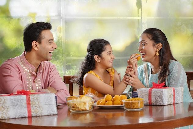 hindu family celebrating diwali
