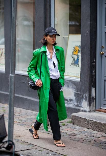 COPENHAGEN, DENMARK - AUGUST 10: Ilenia Toma seen wearing green coat, Celine cap outside The Garment...