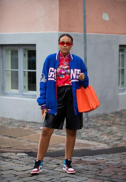 COPENHAGEN, DENMARK - AUGUST 10: A guest is seen wearing blue jacket outside Lovechild on August 10,...