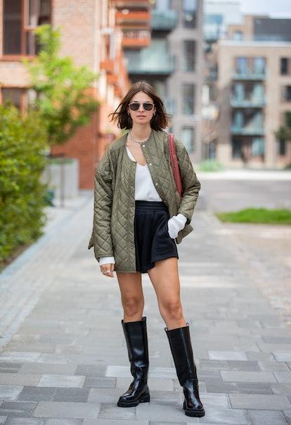 COPENHAGEN, DENMARK - AUGUST 11: Jacqueline Zelwis seen wearing olive puffer jacket, shorts, black b...