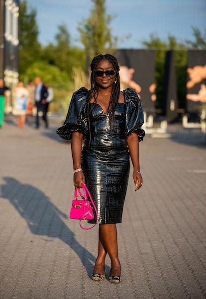 COPENHAGEN, DENMARK - AUGUST 12: Lois Opoku seen wearing black dress, pink Hermes bag outside Rotate...