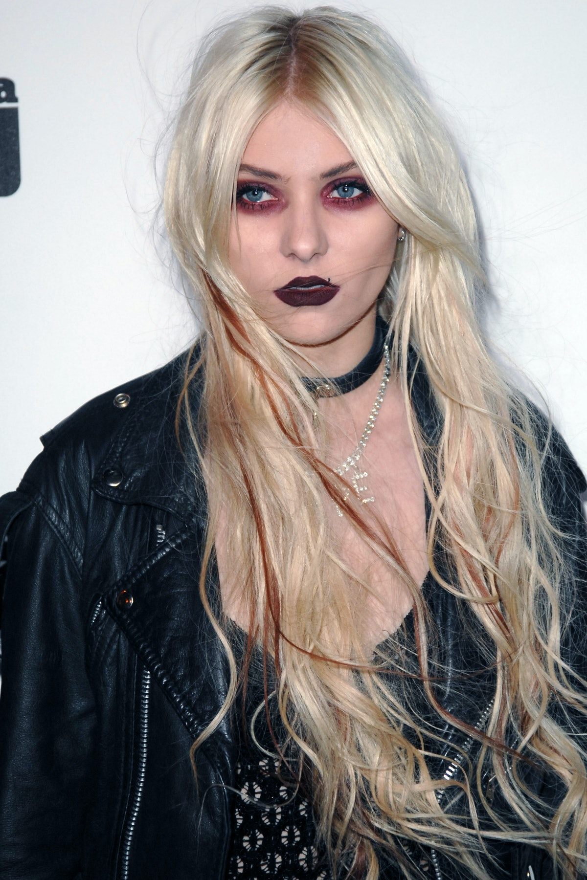 Taylor Momsen of Gossip Girl and The Pretty Reckless wears a modern take on punk makeup, including b...