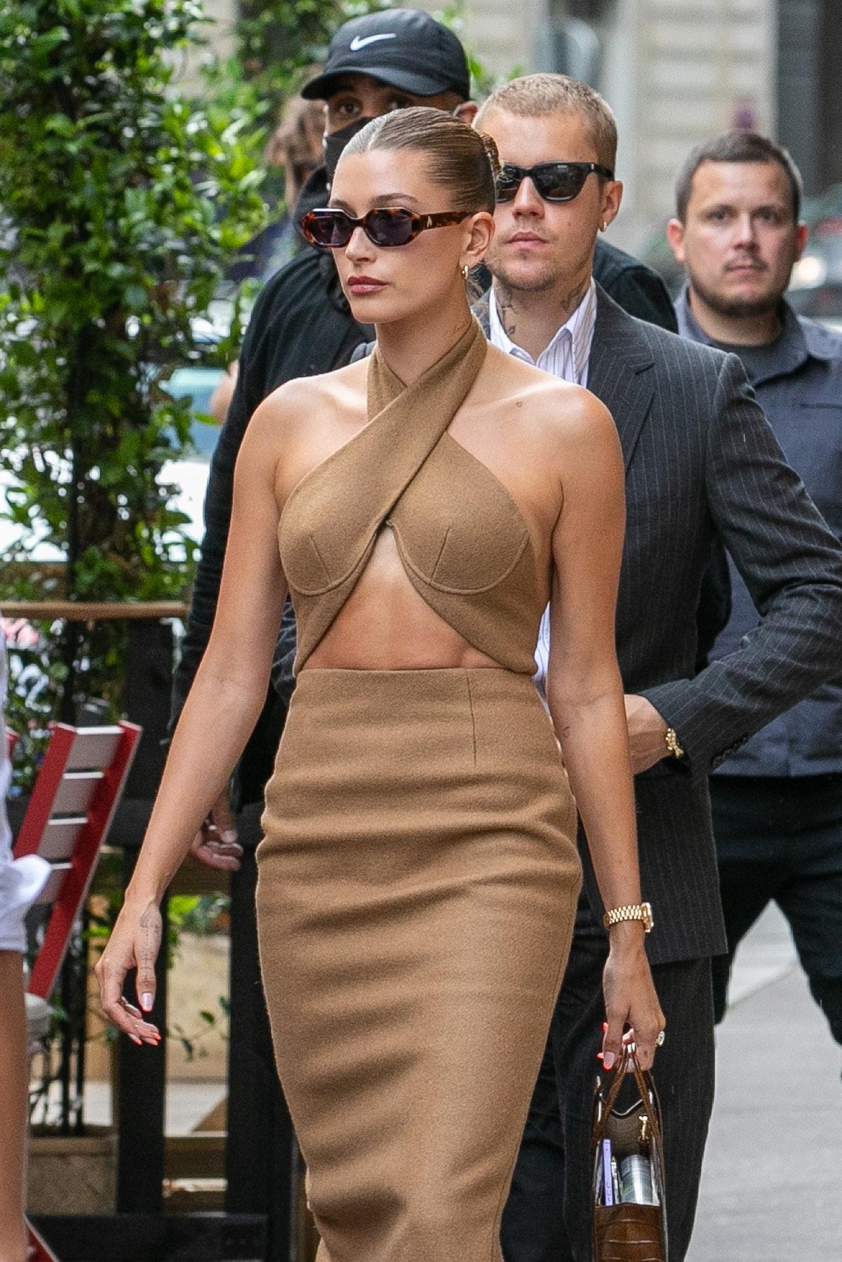 Hailey Bieber wears LaQuan Smith dress and Linda Farrow x THE ATTICO sunglasses while leaving the Di...