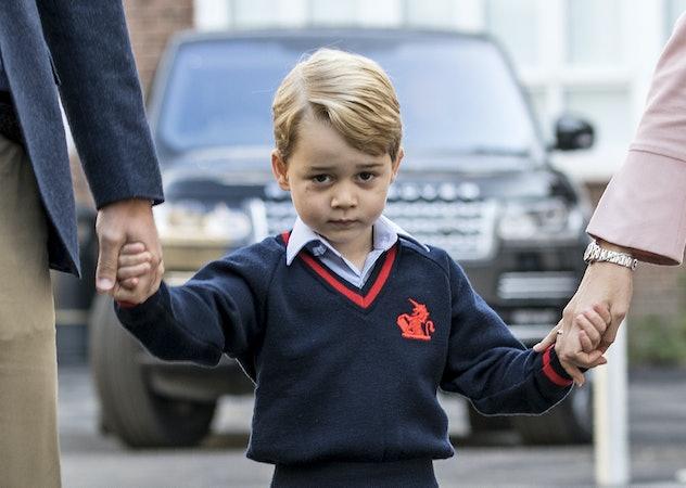 TOPSHOT - Britain's Prince George (C) accompanied by Britain's Prince William (L), Duke of Cambridge...