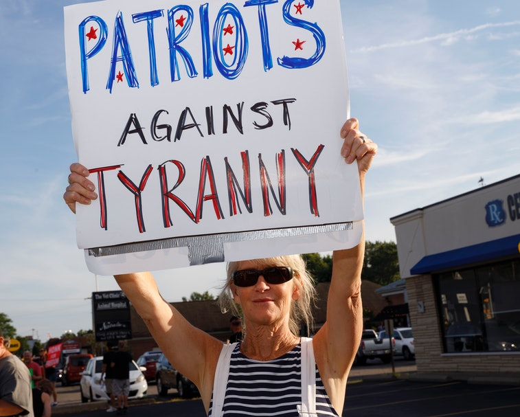 WORTHINGTON, OHIO, UNITED STATES - 2021/08/14: A protester holds sign advocating against businesses ...