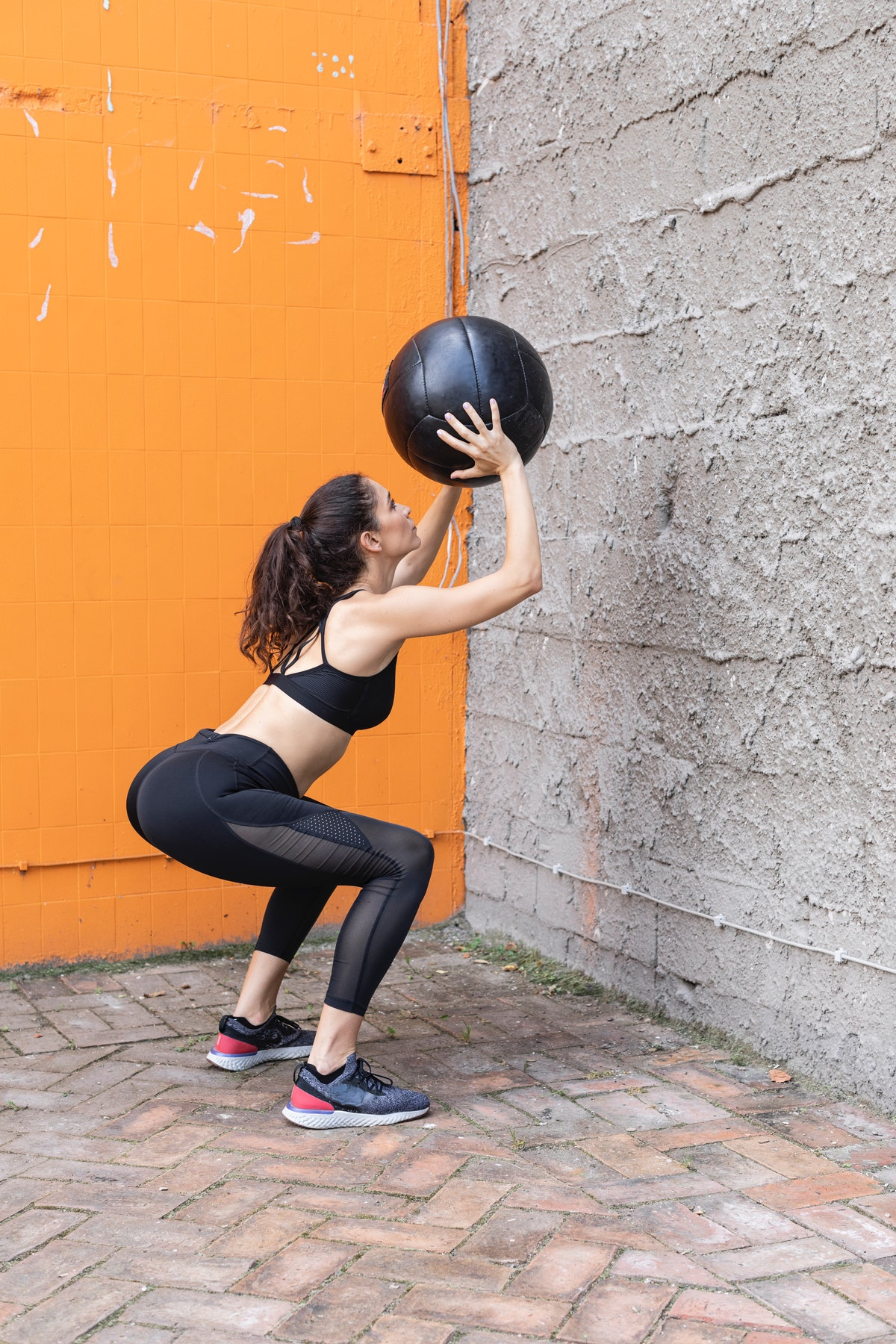 Squat and throw ball against wall in this medicine ball workout.