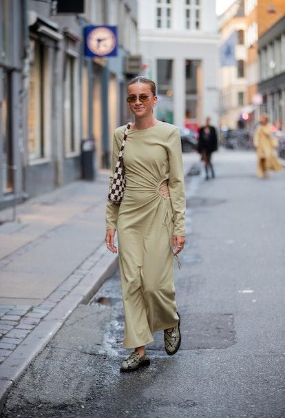 COPENHAGEN, DENMARK - AUGUST 10: A guest is seen wearing olive dress outside Soeren Le Schmidt on Au...