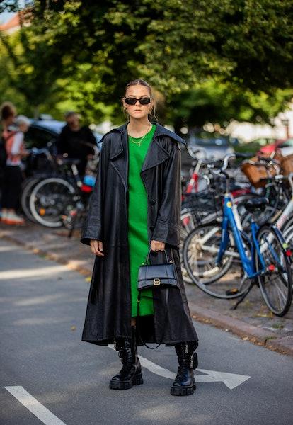 COPENHAGEN, DENMARK - AUGUST 11: Alessa Winter seen wearing green dress, black coat, Balenciaga bag,...