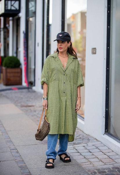 COPENHAGEN, DENMARK - AUGUST 11: Idalia Salsamendi wearing Prada cap, green button up dress outside ...