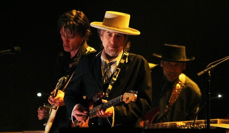 US singer and musician Bob Dylan (C) performs at the Feis Festival in London on June 18, 2011. AFP P...