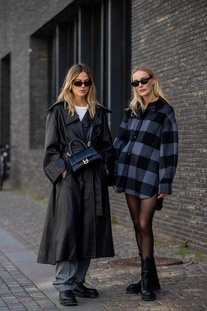 COPENHAGEN, DENMARK - AUGUST 12: Alessa Winter wearing grey pants, black coat, Balenciaga bag, Copen...