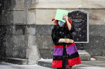 UNITED STATES - DECEMBER 16: Sen. Kyrsten Sinema, D-Ariz., leaves the U.S. Capitol as snow from Wint...