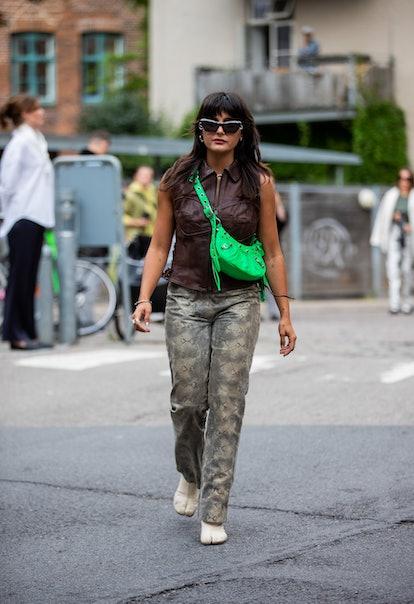 COPENHAGEN, DENMARK - AUGUST 09: Maria Bernad is seen wearing green bag, pants with snake print, bro...