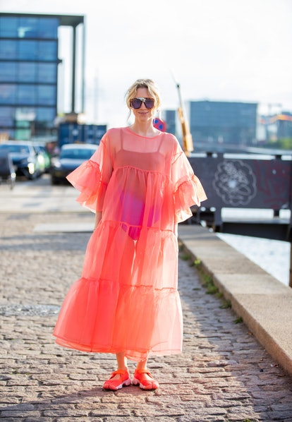 COPENHAGEN, DENMARK - AUGUST 10: A guest seen wearing pink sheer dress outside Rabens Saloner on Aug...