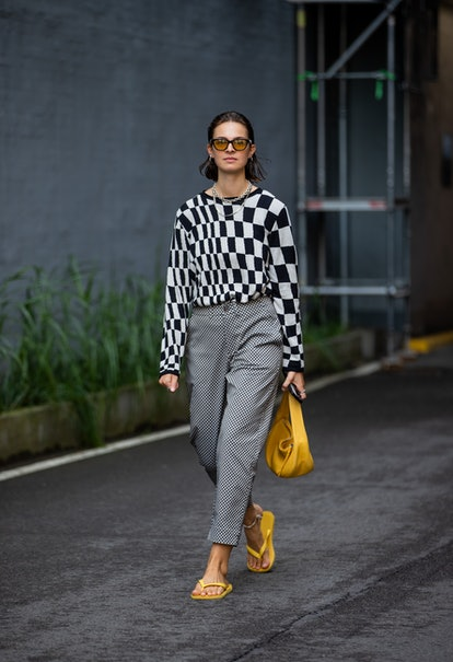 COPENHAGEN, DENMARK - AUGUST 10: Jacqueline Zelwis is seen wearing black white checkered jumper, gre...