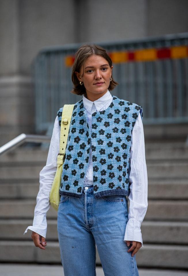 COPENHAGEN, DENMARK - AUGUST 10: A guest is seen wearing vest, denim jeans outside malaikaraiss on A...