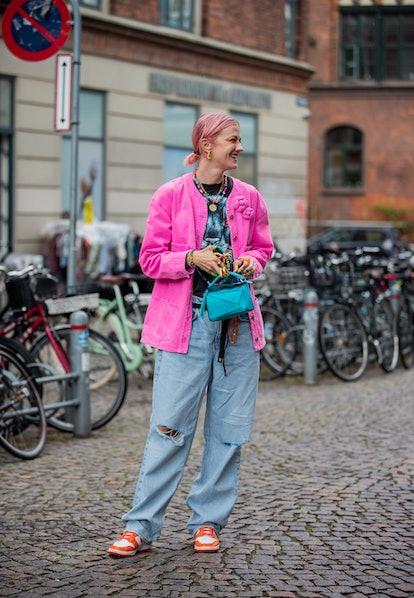 COPENHAGEN, DENMARK - AUGUST 10: Marianne Theodorsen is seen wearing Loewe bag, pink jacket, ripped ...