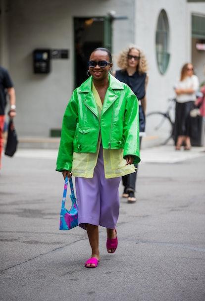 COPENHAGEN, DENMARK - AUGUST 10: A guest is seen wearing green jacket, pink cropped pants outside (d...