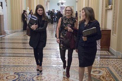 WASHINGTON, DC - NOVEMBER 13: U.S. Senator-elect Kyrsten Sinema (D-AZ) walks through the U.S. Capito...
