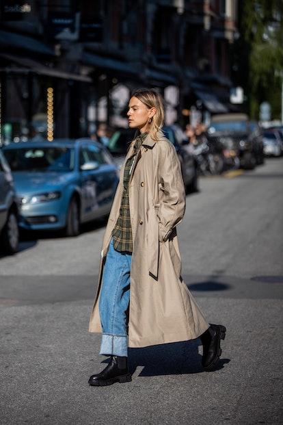 COPENHAGEN, DENMARK - AUGUST 12: Alessa Winter seen wearing denim jeans, trench coat in beige, black...