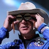 VAN HORN, TEXAS - JULY 20: Jeff Bezos holds the aviation glasses that belonged to Amelia Earhart as ...