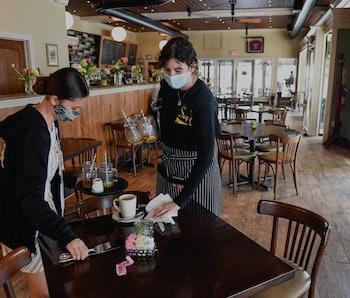 West Reading, PA - May 5: Hostess Kayla Lipari, and server Ana Garcia, clear a table at Say Cheese! ...