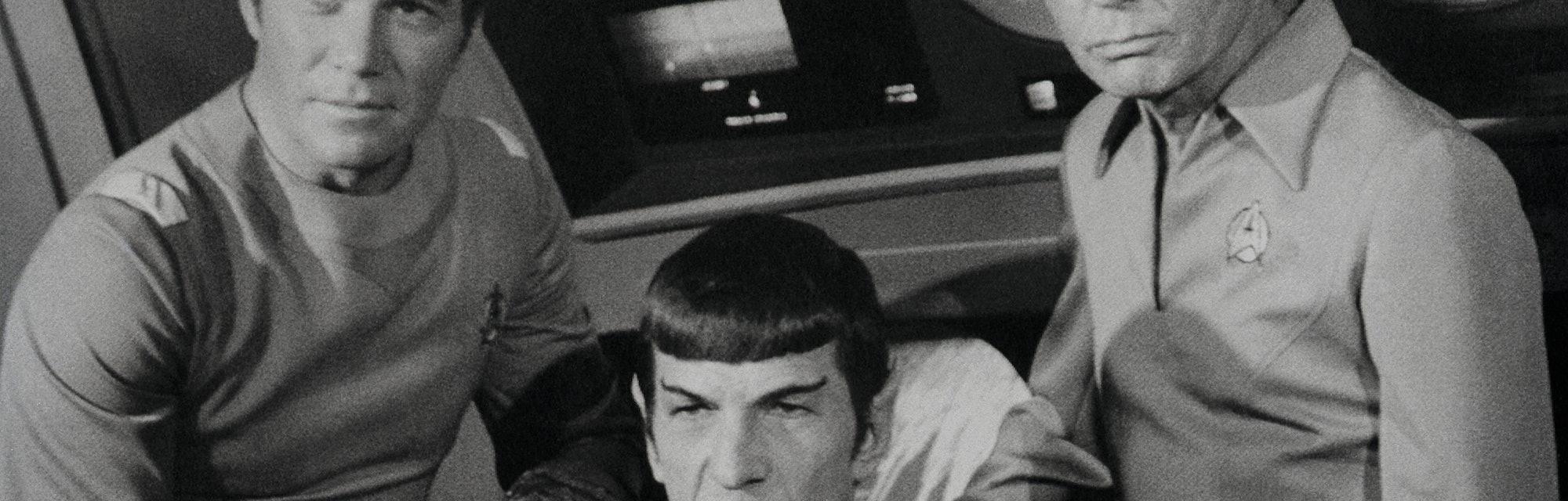 William Shatner, Leonard Nimoy, and DeForest Kelley appear together in the film Star Trek. Shatner p...