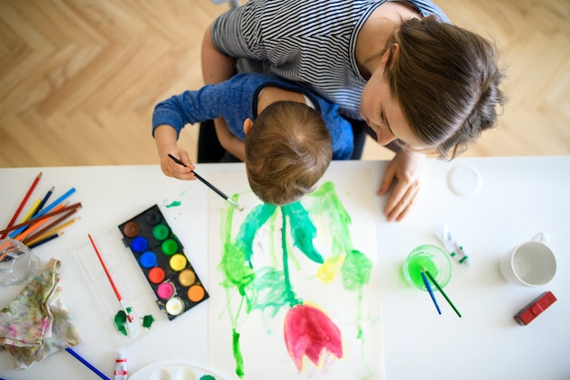 Image of adult and child painting flowers together.