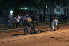 KENOSHA, WISCONSIN, USA - AUGUST 25: (EDITORS NOTE: Image contains graphic content.) Clashes between...