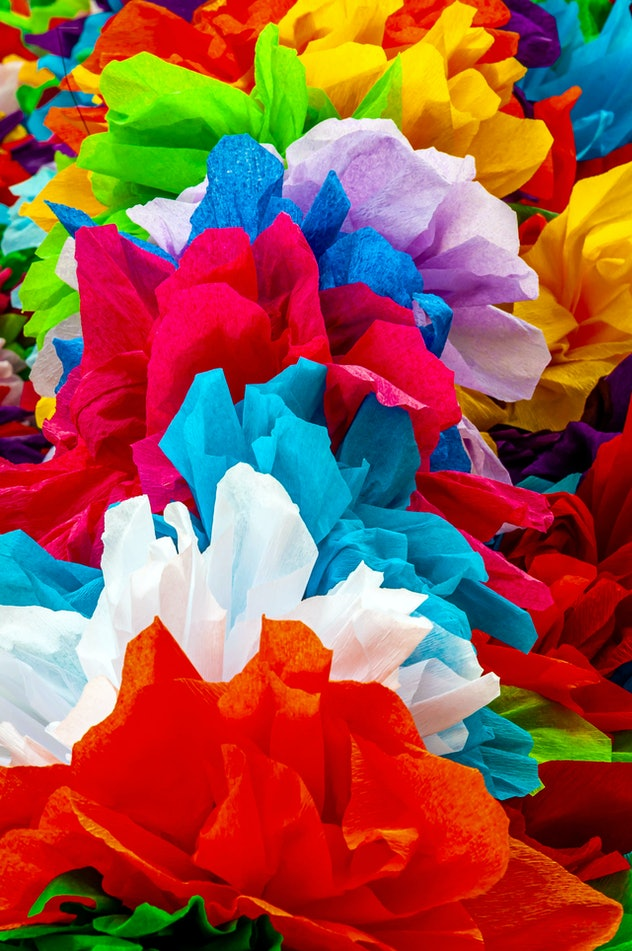An image of a collection of colorful flowers made from tissue paper.