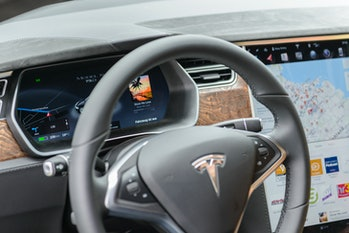 Tesla Model S 75D all-electric, luxury, saloon car dashboard with digital information displays and l...