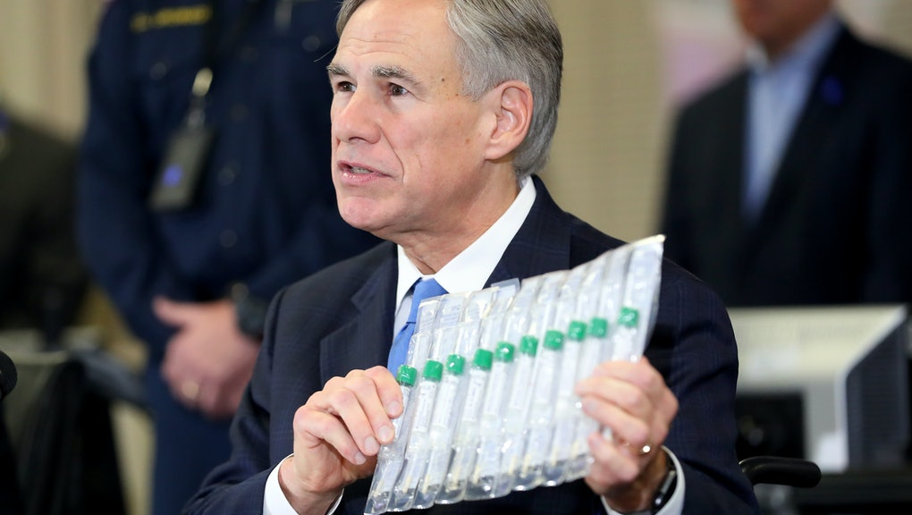 ARLINGTON, TEXAS - MARCH 18: Texas Governor Greg Abbott displays COVID-19 test collection vials as h...