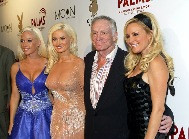 Playboy Founder Hugh Hefner (2nd from right) and girlfriends (L-R) Kendra Wilkinson, Holly Madison a...
