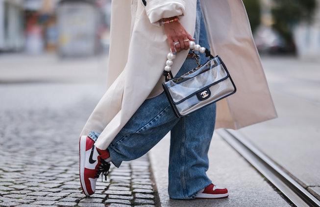 MUNICH, GERMANY - JULY 20: Karin Teigl wearing Maison Margiela destroyed jeans, beige Attire coat, N...