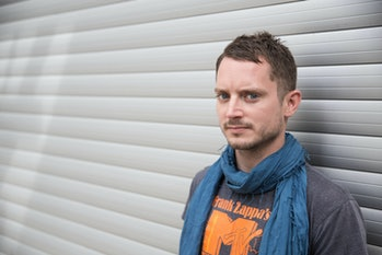 US actor Elijah Wood poses on the grounds of Club Berghain during the festival 'Pop-Kultur' inBerli...