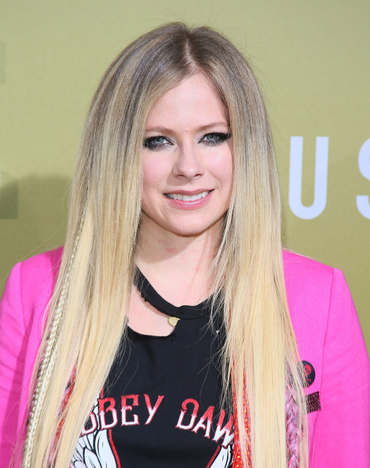 """HOLLYWOOD, CALIFORNIA - MAY 08: Avril Lavigne attends the premiere of MGM's """"The Hustle"""" at ArcLight..."""