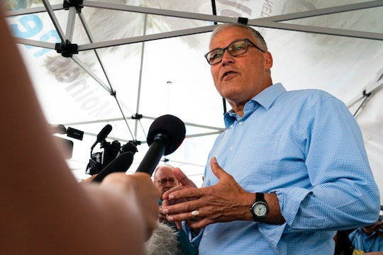 Democratic presidential candidate and Washington Governor Jay Inslee speaks with reporters at the Io...