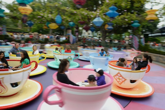 guests at disneyland spinning in tea cup ride